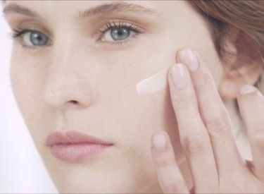Bioderma - woman applying cream on the face